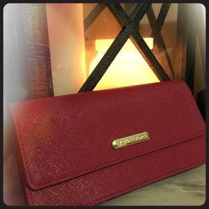 MK sleek red wallet